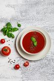 Traditional Spanish cold tomato soup gazpacho in a white bowl on a dark stone background. Traditional Spanish food. Concept of Spa. Nish cold soup made of ripe stock photography