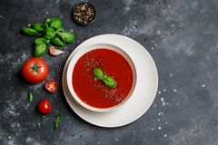 Traditional Spanish cold tomato soup gazpacho in a white bowl on a dark stone background. Traditional Spanish food. Concept of Spa. Nish cold soup made of ripe royalty free stock photography