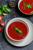 Traditional Spanish cold tomato soup gazpacho in a white bowl on a dark stone background. Traditional Spanish food. Concept of Spa. Nish cold soup made of ripe royalty free stock images