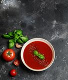 Traditional Spanish cold tomato soup gazpacho in a white bowl on a dark stone background. Traditional Spanish food. Concept of Spa. Nish cold soup made of ripe stock photos