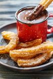 Churros with hot chocolate. Royalty Free Stock Photo