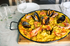 Traditional spanish dish paella with prawns and mussels. Closeup of a traditional tasty spanish dish paella served with prawns and mussels Stock Photography