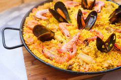 Traditional spanish dish paella with prawns and mussels. Closeup of a traditional tasty spanish dish paella served with prawns and mussels Royalty Free Stock Images