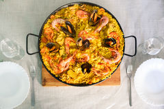 Traditional spanish dish paella with prawns and mussels. Closeup of a traditional tasty spanish dish paella served with prawns and mussels Stock Photo