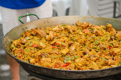 Traditional spanish dish paella with prawns and mussels. Closeup of a traditional tasty spanish dish paella served with meat and vegetables Stock Image