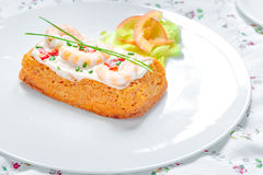 Traditional Spanish fish cake. Hake cake with tomato, shrimps, chive and salad cream Royalty Free Stock Images