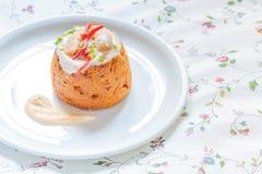 Traditional Spanish fish cake. Hake cake with tomato, shrimps and salad cream Stock Image