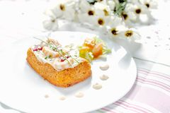 Traditional Spanish fish cake. Hake cake with tomato, shrimps and salad cream. Traditional Spanish fish cake. Hake cake with tomato, shrimps and salad cream Stock Photos