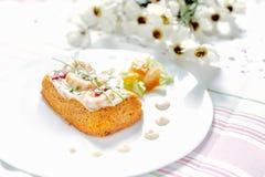 Traditional Spanish fish cake. Hake cake with tomato, shrimps and salad cream. Stock Photos