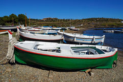 Traditional Spanish fishing boats on the beach. Traditional Spanish fishing boats on a beach of the Mediterranean sea, Cadaques, Costa Brava, Spain Royalty Free Stock Image