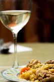 Traditional Spanish food, rice with rabbit and wine glass Royalty Free Stock Photography