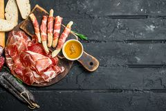 Traditional Spanish ham with ciabatta and breadsticks stock photo