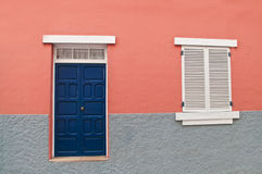 Traditional spanish home facade with pink wall Royalty Free Stock Photo