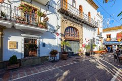 Traditional Spanish narrow street with souvenir shop and beautiful architecture in historical part of town Royalty Free Stock Image
