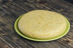 Traditional spanish omelette. Traditional spanish omelette, called `Tortilla de patata`, a typical spanish dish of eggs, potatoes and olive oil Royalty Free Stock Photography