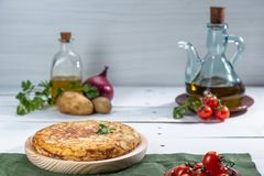 Traditional spanish omelette on wooden table royalty free stock photography