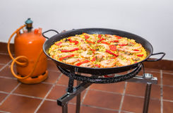 Traditional spanish paella cooking in a pan stock photo