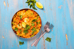 Traditional spanish paella dish with seafood, peas, rice and chicken Royalty Free Stock Photography