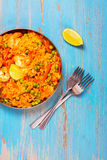 Traditional spanish paella dish with seafood, peas, rice and chicken Stock Photos
