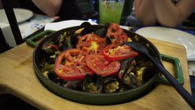 Traditional Spanish Paella with seafood and vegetables in a pan.