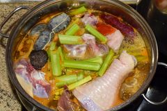 Traditional Spanish pork and chiken stew with blood sausage. Nutrition concept. stock images