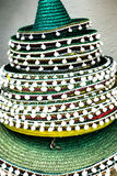 Traditional Spanish straw hats with pompoms Royalty Free Stock Photos