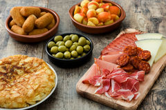 Traditional spanish tapas. Croquettes, olives, omelette, ham and patatas bravas Royalty Free Stock Photography
