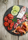 Traditional spanish tapas or italian antipasti. Still life, food and drink, holidays concept. Assortment of spanish tapas or italian antipasti, jamon, prosciutto Royalty Free Stock Photos