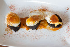 Traditional Spanish tapas of quail egg sausage and cayenne.  Royalty Free Stock Photo