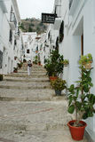Traditional Spanish white village of Frigiliana with typical stairs Royalty Free Stock Images