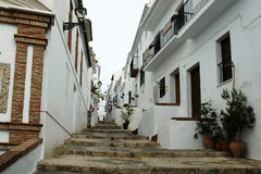 Traditional Spanish white village of Frigiliana with typical stairs Stock Image