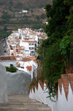 Traditional Spanish white village of Frigiliana with typical stairs Stock Photography