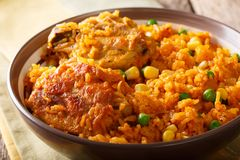 Traditional spicy Brazilian food: chicken and rice close-up on a. Traditional spicy Brazilian food: Galinhada chicken and rice close-up on a plate. horizontal stock image