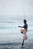 Traditional Sri Lanka: stilt fishing in ocean surf Stock Photo