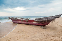 Traditional Sri Lankan fishing boat on  sandy beach. Royalty Free Stock Photography