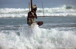 Traditional sri lankan stilt fisherman Stock Images
