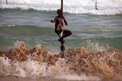 Traditional sri lankan stilt fisherman royalty free stock photo