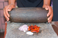Traditional Sri Lankan way of grinding spices. With the grinding stone. Before the electric blenders, the spices were painstakingly ground manually in all Royalty Free Stock Image