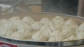 Traditional steamed chinese dumpling while cooking stock video