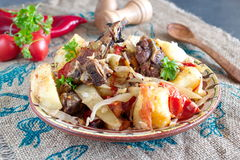 Traditional stew with lamb chops and vegetables: onion, cabbage, potato, tomato, paprika in a bowl on a cloth background. Healthy eating concept Stock Photos