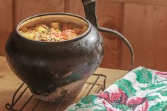 Traditional stew meal cooked in wood-fired oven Royalty Free Stock Photos