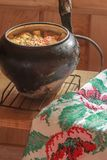 Traditional stew meal with handmade embroidery Stock Images