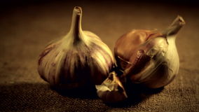 Traditional still life.The garlic. Traditional  Ukrainian still life. Warm sacking background. Paning from right to left stock video