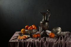 Free Traditional Still Life With Tin Old Jug And Tangerines Stock Photography - 141490042