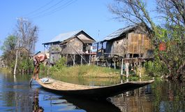 Traditional stilts houses contrasting with blue sky - Inle Lake, Myanmar stock photo