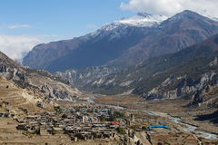 Traditional stone build village of Manang. Mountains in the background. Annapurna area, Himalaya, Nepal Stock Images