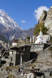 Traditional stone build village of Manang. Mountains in the background. Annapurna area, Himalaya, Nepal Stock Photography