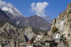 Traditional stone build village of Manang. Mountains in the background. Annapurna area, Himalaya, Nepal Stock Image