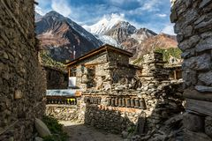 Traditional stone build village of Manang. Mountains in the background. Stock Photography