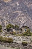Traditional stone buildings in Muktinath village in Upper Mustang area royalty free stock photos